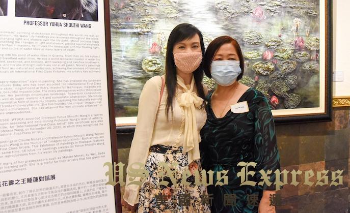 王老師美術學院院長汪蕾與蒙市市長饶影凡。龐可陽攝